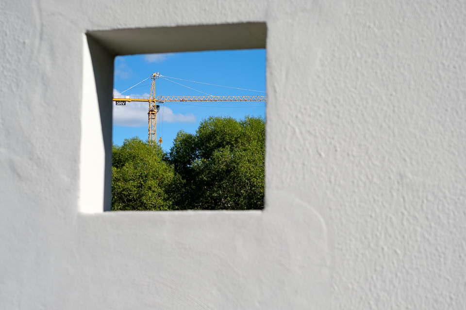 Crane through a hole in the wall