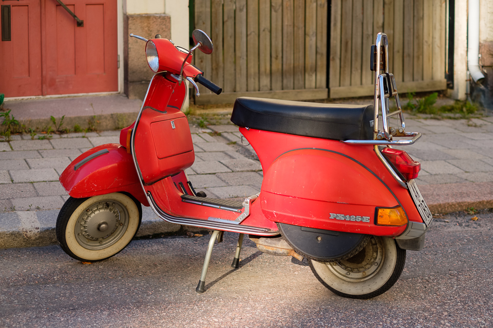 A beaten Piaggio scooter