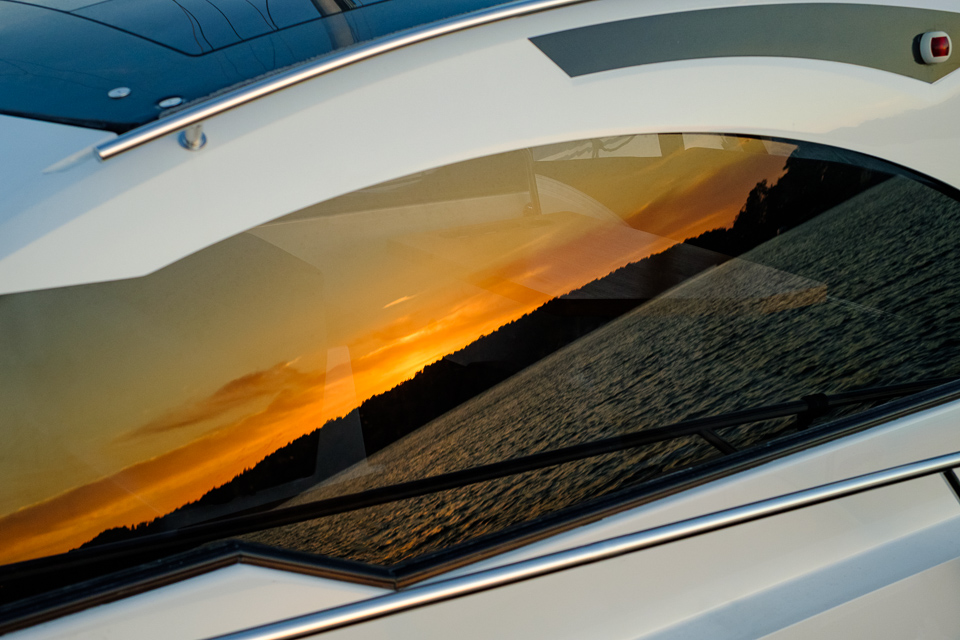 The sunset reflecting from a boat window