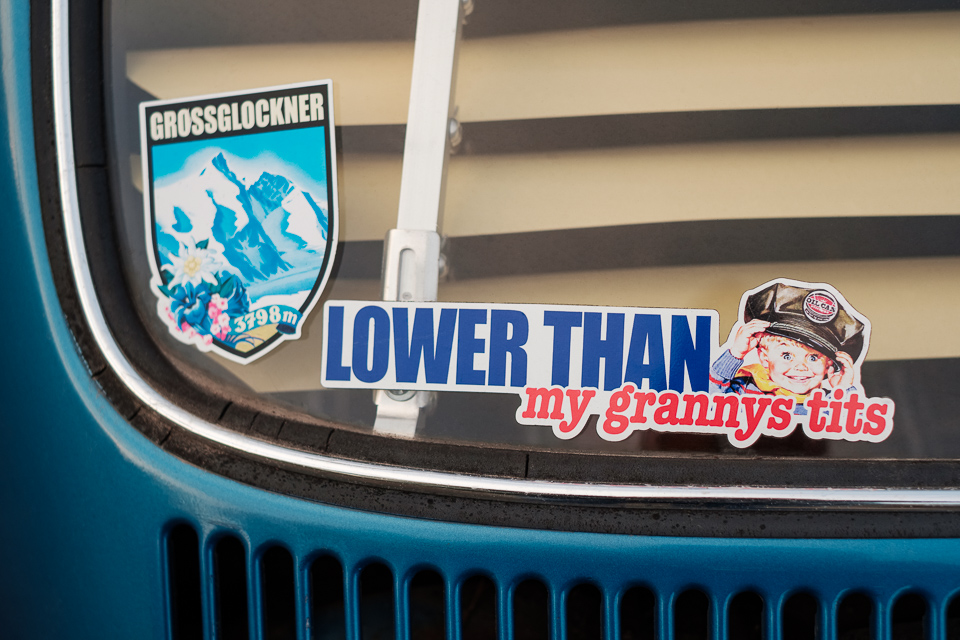 """VW beetle with a """"Lower than my grannys tits""""-sticker"""