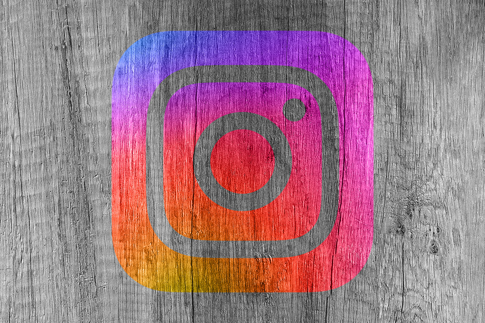 Instagram logo on wood